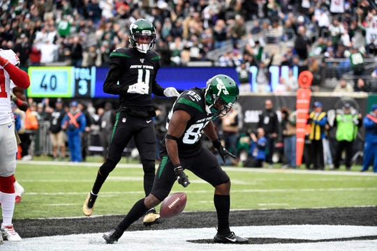 New York Jets wide receiver Jamison Crowder (82) celebrates his touchdown in the first half against the New York Giants. The New York Jets host the New York Giants in an NFL game on Sunday, Nov. 10, 2019, in East Rutherford.