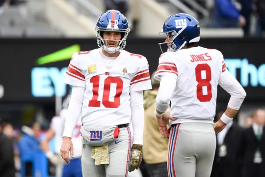 New York Giants quarterbacks Eli Manning (10) and Daniel Jones (8) warm up before facing the Jets on Sunday, Nov. 10, 2019, in East Rutherford.