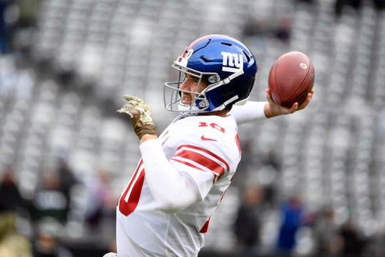 New York Giants quarterback Eli Manning (10) warms up on the field before facing the New York Jets on Sunday, Nov. 10, 2019, in East Rutherford.