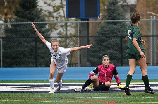 Madisyn Pilla (no. 4) of Pingry (white), reacts as she successfully scores against DePaul goalie, Kayla Bower in the first half during the Non-Public A final at Kean University in Union on 11/10/19.