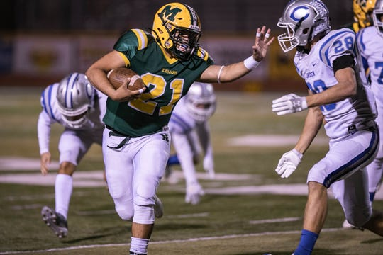 The Mayfield Trojans defeated the Carlsbad Cavemen to advance to the quarterfinals of the 6A state football tournament.
