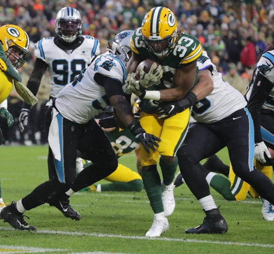 Green Bay Packers running back Aaron Jones (33) scored s touchdown on s one-yard run during the second quarter of the game against the Carolina Panthers Sunday, November 10, 2019 at Lambeau Field in Green Bay, Wis.