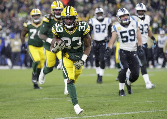 Green Bay Packers running back Aaron Jones (33) scores a touchdown against the Carolina Panthers in the third quarter Sunday, November 10, 2019, at Lambeau Field in Green Bay, Wis.