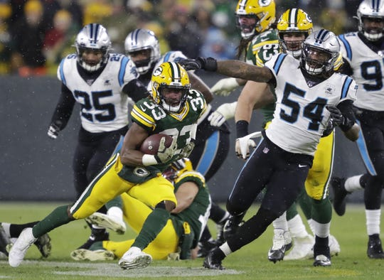 Green Bay Packers running back Aaron Jones (33) breaks away for a long first down run against Carolina Panthers outside linebacker Shaq Thompson (54) in the third quarter Sunday, November 10, 2019, at Lambeau Field in Green Bay, Wis.