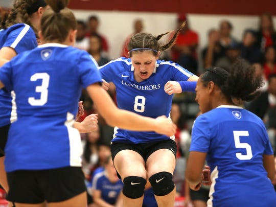 Mackeznie Harrell celebrates a Conqueror point with a celebratory stomp.