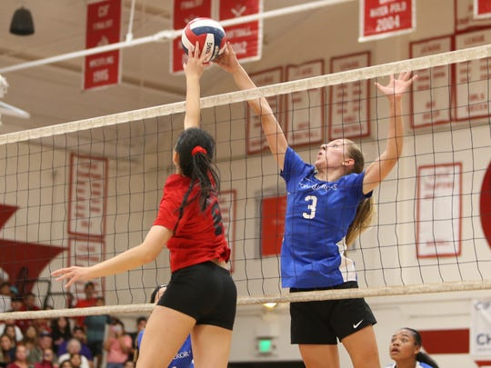 Desert Christian Academy freshman Kate Smith goes up for the ball against Garden Grove in the CIF-SS Division 7 final.