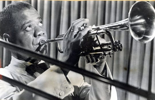 """Jazz Ambassador"" Louis Armstrong in 1962 with his golden horn at the Chi Chi in Palm Springs."