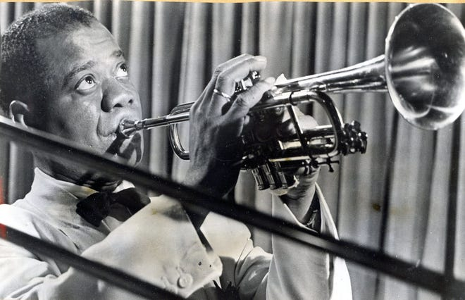 """""""Jazz Ambassador"""" Louis Armstrong in 1962 with his golden horn at the Chi Chi in Palm Springs."""