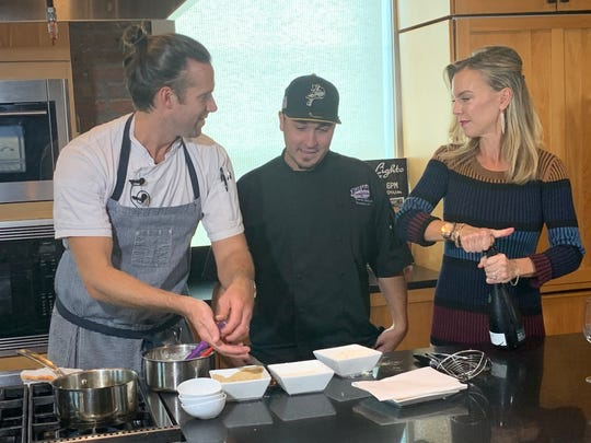 Angelena's executive chef James Briscione, far left, Blue Wahoos chef Travis Wilson (center), and Angelena's wine director and co-owner Brooke Parkhurst on a video shoot and food sampling at Bodacious Shops kitchen on Palafox Street.