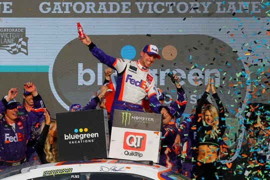 Denny Hamlin, driver of the #11 FedEx Ground Toyota, celebrates in Victory Lane after winning the Monster Energy NASCAR Cup Series Bluegreen Vacations 500 at ISM Raceway on November 10, 2019 in Avondale, Arizona.