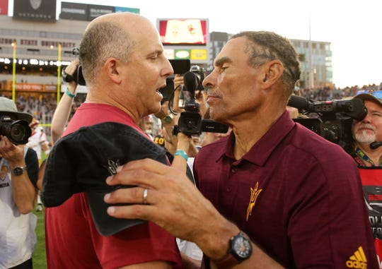 USC head coach Clay Helton greets Arizona State head coach Herm Edwards after the Trojans defeated the Sun Devils 31-26 on Nov. 9, 2019 in Tempe, Ariz.