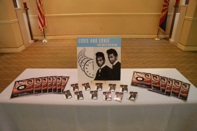 "A display features photographs of Eddie & Ernie, and album art for their track ""Time Waits for No One,"" at a headstone dedication ceremony for Ernie Johnson at Resthaven/Carr-Tenney Mortuary Chapel on Nov. 9, 2019."