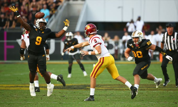 USC Trojans quarterback Kedon Slovis (9) throws a pass against Arizona State Sun Devils defensive lineman Stephon Wright (9) in the second half on Nov. 9, 2019 in Tempe, Ariz.