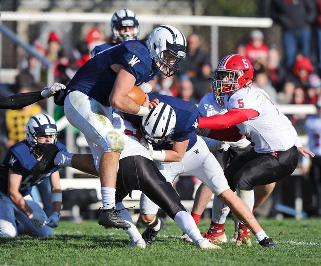 Wyomissing's Evan Niedrowski (44) runs for a first down during a District 3 playoff game last season. Niedrowski is one of several backfield threats Wyomissing has in its high-scoring Wing-T offense.