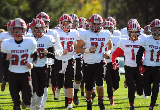 The Annville-Cleona Dutmen take the field prior to the start of a District III 3A semifinal game between the A-C Dutchmen and the Wyomissing Spartans on Saturday, Nov.9, 2019 at Wyomissing's stadium.