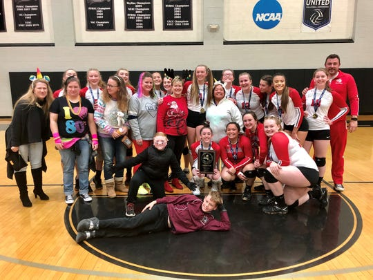 The Red Hook volleyball team is joined on the court at Bard College by a group of fans - relatives, schoolmates and teachers - dressed in costumes as they celebrate their Section 9 championship.