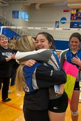 Millbrook sophomore Olivia Fried gets a congratulatory hug from former teammate Sam McKenna after the Blazers won the Section 9 Class C championship on Sunday.