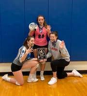 Millbrook seniors Cecilia Dignan, Bree McDermott and Erin Fox hold up five fingers, signifying the Blazers' fifth straight Section 9 Class C championship.