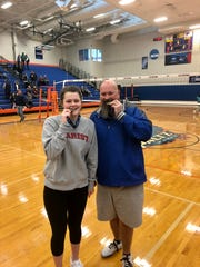 Senior Erin Fox and coach Shawn Stoliker pose with their medals after the Millbrook volleyball team defeated Burke Catholic to win the Section 9 Class C title.