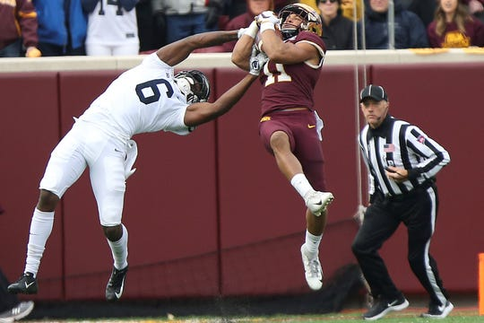 Minnesota defensive back Antoine Winfield Jr. (11) intercepts the ball intended for Penn State wide receiver Justin Shorter (6) during an NCAA college football game Saturday, Nov. 9, 2019, in Minneapolis. (AP Photo/Stacy Bengs)