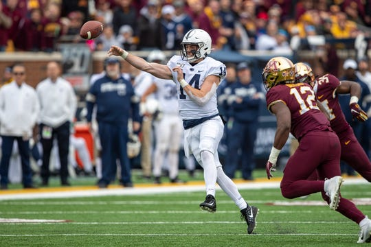 Nov 9, 2019; Minneapolis, MN, USA; Penn State Nittany Lions quarterback Sean Clifford (14) throws a pass in the second half against the Minnesota Golden Gophers at TCF Bank Stadium. Mandatory Credit: Jesse Johnson-USA TODAY Sports