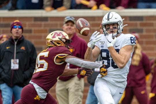 Nov 9, 2019; Minneapolis, MN, USA; Penn State Nittany Lions wide receiver Dan Chisena (88) drops a pass as Minnesota Golden Gophers defensive back Justus Harris (26) plays defense in the second half at TCF Bank Stadium. Mandatory Credit: Jesse Johnson-USA TODAY Sports