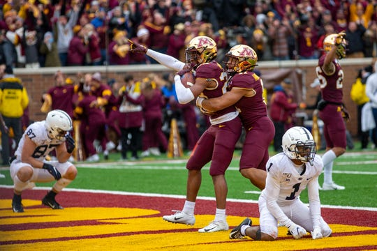 Nov 9, 2019; Minneapolis, MN, USA; Minnesota Golden Gophers defensive back Jordan Howden (23) celebrates with defensive back Antoine Winfield Jr. (11) after intercepting a pass to defeat the Penn State Nittany Lions at TCF Bank Stadium. Mandatory Credit: Jesse Johnson-USA TODAY Sports