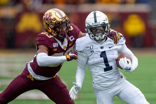 Nov 9, 2019; Minneapolis, MN, USA; Penn State Nittany Lions wide receiver KJ Hamler (1) rushes with the ball past Minnesota Golden Gophers defensive back Jordan Howden (23) in the second half at TCF Bank Stadium. Mandatory Credit: Jesse Johnson-USA TODAY Sports