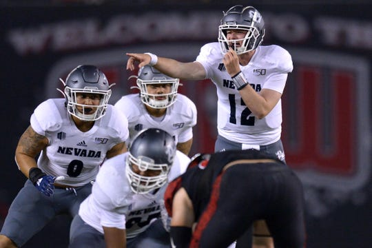 Nevada quarterback Carson Strong directs the Wolf Pack offense against San Diego State on Saturday.
