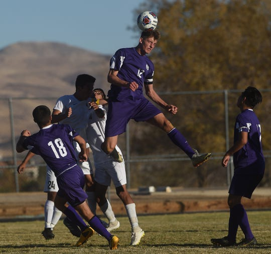 Spanish Springs' Ryan Rutherford (12) heads the ball while taking on Galena during their northern region boys soccer championship game at Hug High in Reno on Nov. 9, 2019.
