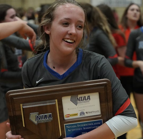 Reno's Abbey Leff holds onto the NIAA Northern 4A regional plaque after the Huskies came back from a 2-1 deficit to win the title.