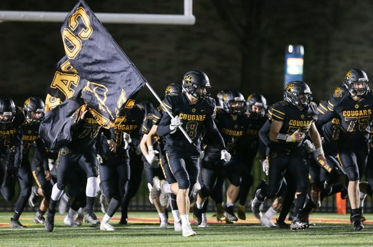 The Honeoye Falls-Lima Cougars are introduced before the Section V Class B football championship against the Livonia Bulldogs at Growney Stadium.