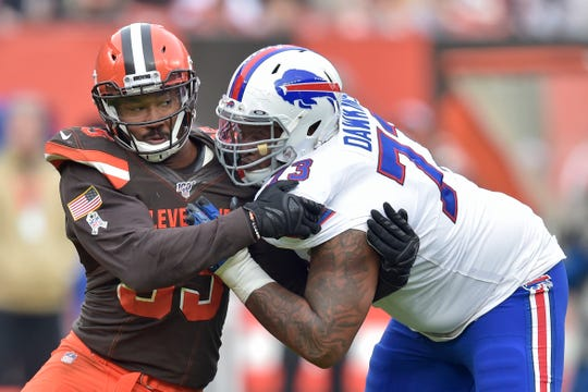 Cleveland Browns defensive end Myles Garrett, left, tries to get past Buffalo Bills offensive tackle Dion Dawkins during the first half of an NFL football game, Sunday, Nov. 10, 2019, in Cleveland. (AP Photo/David Richard)