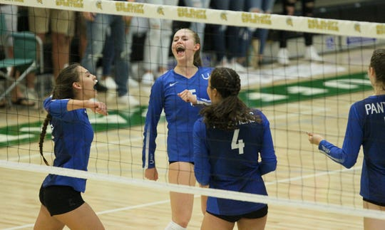 U-Prep's Kaleia Mizuta (3), left, Madi Friebel (5), Ashlee Kraft (4) celebrate after the Panthers score a point. The Panthers defeated West Valley 25-12, 25-13, 25-15 to claim the Northern Section Division IV champion title Saturday, Nov. 9, 2019 in Red Bluff.