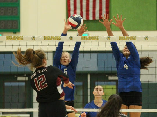 U-Prep's Emily Cox (6) and Ashlee Kraft (4) go up for a block against West Valley's Azraya Willis (12) in the third game. The Panthers defeated West Valley 25-12, 25-13, 25-15 to claim the Northern Section Division IV champion title Saturday, Nov. 9, 2019 in Red Bluff.