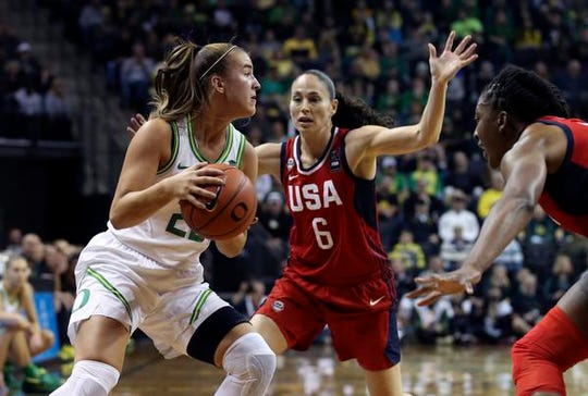 Oregon's Sabrina Ionescu, left, move the ball under pressure from U.S.'s Sue Bird, center, and Nnemkadi Ogwumike during the first half of an women's exhibition basketball game in Eugene, Ore., Saturday, Nov. 9, 2019. (AP Photo/Chris Pietsch)