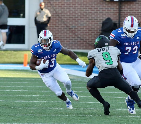 Louisiana Tech's Justin Henderson scores against North Texas Saturday afternoon in Joe Aillet Stadium.