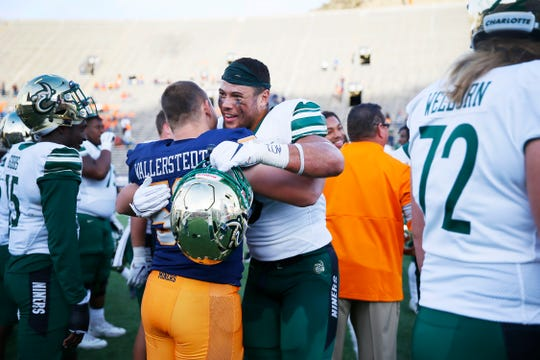 UTEP and Charlotte after the game Saturday, Nov. 9, at the Sun Bowl in El Paso. Charlotte won 28-21.