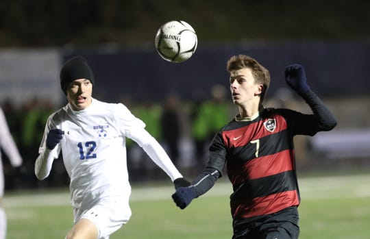 Rye's Michael Traynor (7) works against Goshen's Ethan Zirilli (12) in the NYSPHSAA class A boys soccer regional finals at Pace University in Pleasantville on Saturday, November 9, 2019.
