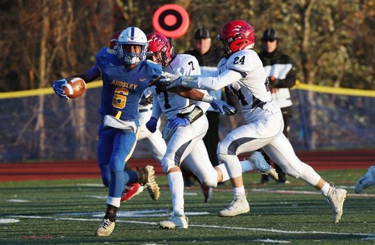 Ardsley's Jalen Osbourne (6) breaks away from Byram Hills' Ryan Abatemarco  (24) as he runs for a first half touchdown during the Section 1 Class B championship at Mahopac High School Nov. 9, 2019.