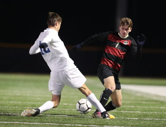 Rye's Michael Traynor (7) works the ball  in the NYSPHSAA class A boys soccer regional finals against Goshen at Pace University in Pleasantville on Saturday, November 9, 2019.