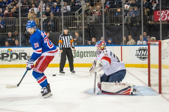 New York Rangers center Chris Kreider (20) tips the puck past Florida Panthers goaltender Sam Montembeault (33) for a goal during the second period of an NHL hockey game, Sunday, Nov. 10, 2019, in New York. (AP Photo/Corey Sipkin)
