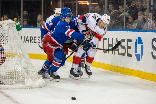 New York Rangers center Brett Howden (21) and defenseman Brady Skjei (76) tangle with Florida Panthers center Dominic Toninato (14) during the first period of an NHL hockey game, Sunday, Nov. 10, 2019, in New York. (AP Photo/Corey Sipkin)