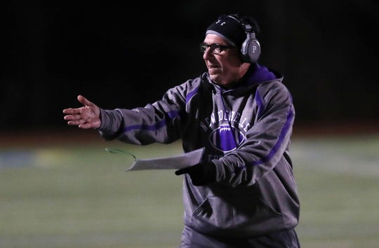 Coach Lou DiRienzo on the field as New Rochelle defeated Carmel to win the Section 1 championship at Mahopac High School Nov. 9, 2019.