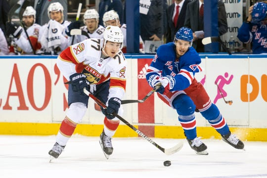 Florida Panthers center Frank Vatrano (77) skates against New York Rangers center Brett Howden (21) during the first period of an NHL hockey game, Sunday, Nov. 10, 2019, in New York. (AP Photo/Corey Sipkin)