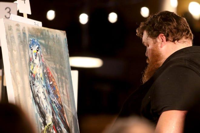 Joshua Levi Mindemann paints at Art Battle Saturday, Nov. 9, 2019, at The Warehouse.