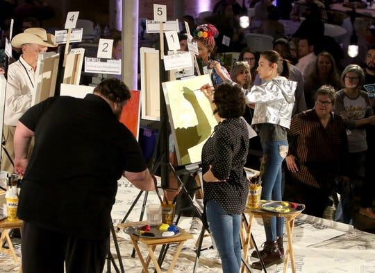 Painters work quickly at Art Battle Saturday, Nov. 9, 2019, at The Warehouse.