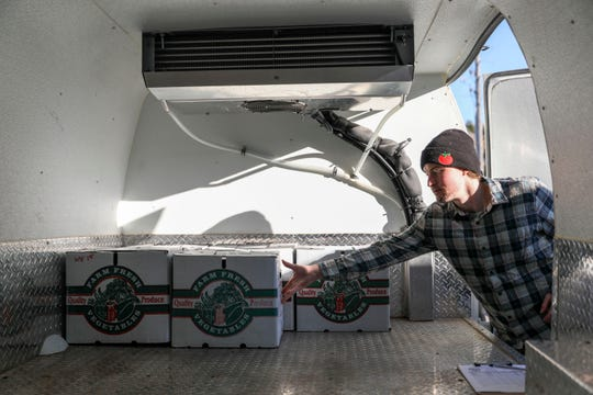 Bryan Bjorklund, program associate, loads boxes of produce into a refrigerated van at the Food Hub in Iowa City on Thursday, Oct. 17, 2019. The hub acts as a broker between small-scale farms looking to fill gaps in the local market, such as local schools or nursing homes who want to serve fresh produce.