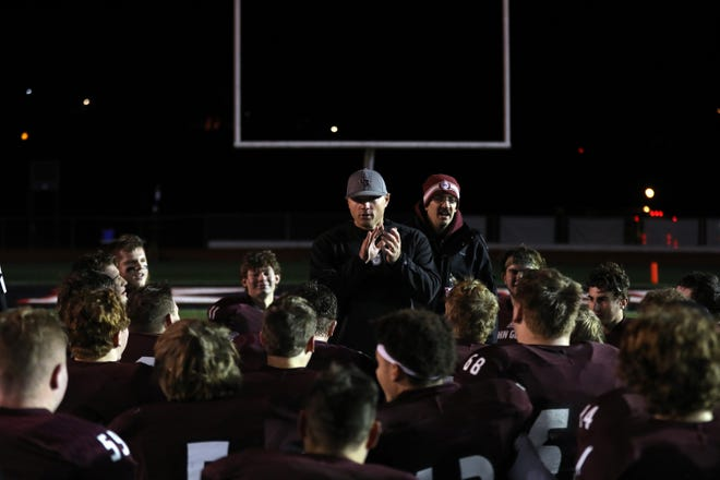 John Glenn head coach Matt Edwards congratulates his team after beating St. Clairsville in a Division IV, Region 15 playoff game at McConagha Stadium in New Concord.