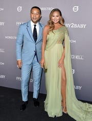 John Legend and Chrissy Teigen attend the Baby2Baby Gala Presented By Paul Mitchell at 3LABS on Nov. 9, 2019, in Culver City, California.